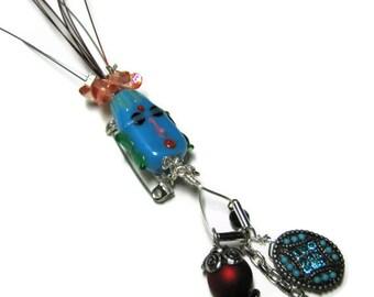 Whimsical Lampwork  Pin, Tiki Head Pin.