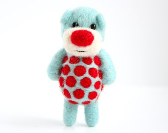 Bright blue miniature felted pocket bear with red polka dots