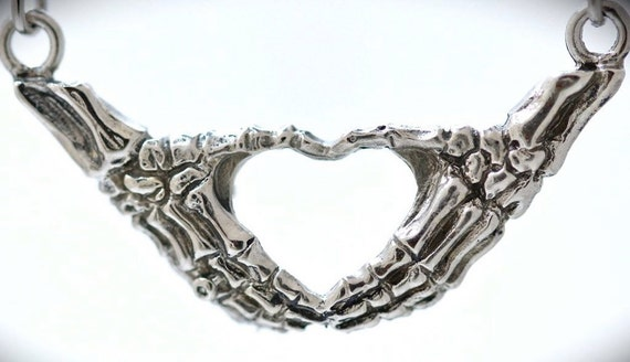skeleton hands making an I heart you sign necklace Blue Bayer Design NYC