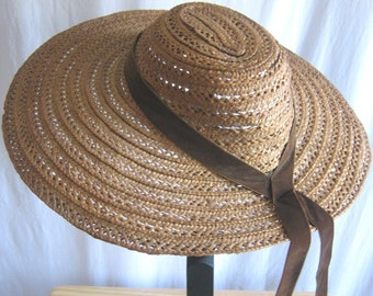 Hat, antique straw, brown velvet ribbon, Edwardian to the 1930s. Beautiful shape, a really sweet hat
