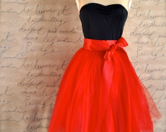 Red tulle skirt for women lined in red satin with a red satin ribbon waist.