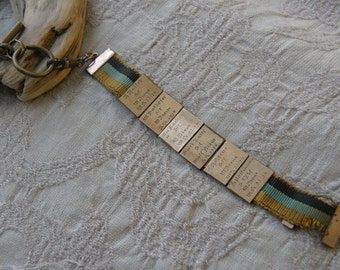 Vintage ribbon fob from the 1920's with 6 gold slides engraved with names