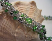 Silver necklace with green crystals, made in Nova Scotia, silver thread, seed beads, swarovski crystals, silver plated clasp, anti allergic