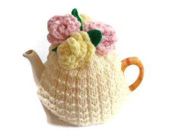 tea  cosie cozy hand knitted with large lemon  and pink  crochet roses