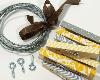 Clothesline Kit. Grey and Yellow Clothespins and Hanging Wire