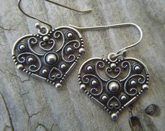 Dangle heart earrings in sterling silver