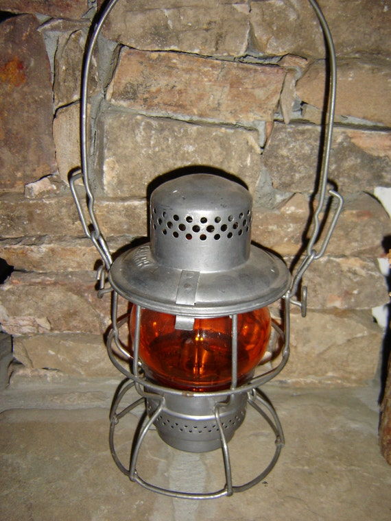 l n railroad vintage railroad lantern with orange glass. Black Bedroom Furniture Sets. Home Design Ideas