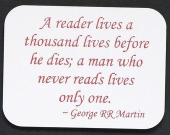 """Magnet says """"A reader lives a thousand lives..."""", laser engraved, custom color"""