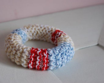 Knitted cotton bracelet in red, blue and sand