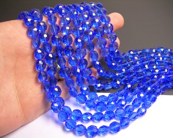 Crystal faceted oval round - 50pcs -  9 mm - AA quality - dark blue  - 18 inch strand