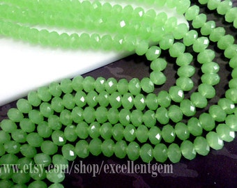 72pcs and up, Faceted crystal roundel in milky green color - 8x6mm