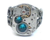 Classic Steampunk Ring, Emerald Green Swarovski Crystals, Vintage Ruby Jeweled Watch Movement, Adjustable Filigree Band,Edwardian Fantasy