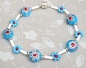 Children, teen or young adult Millefiori glass puffed round aqua blue flower beads bracelet on hand beaded daisy chain with Magnetic clasp.