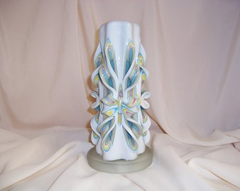 Carved candle- 9 inch hand carved purple, blue, yellow and white candle