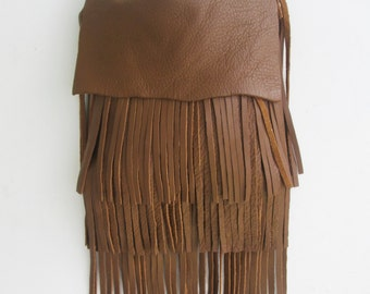 brown saddle leather handbag messenger with fringe, by Tuscada. Made to order.
