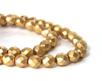 Metallic gold glass beads, matte finish 8mm faceted round, full & half strands available  (668G)