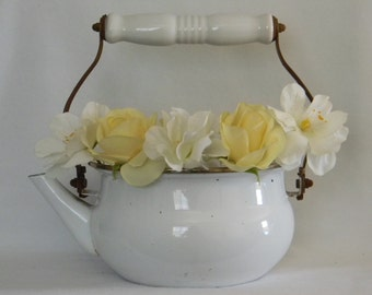 Vintage enamel tea kettle in white