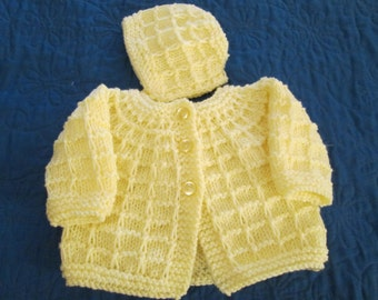 handknit yellow sweater and cap