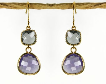 Angles and dangles. A Square and a teardrop, sparkly earrings, gold framed charcoal & amethyst purple faceted gems