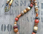 Multi Color Asymmetrical Necklace in Brown, Black, Burnt Orange, Cream and Red