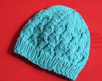 Beautiful blue baby knitted wool hat with eyelet pattern