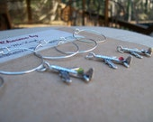 Set of airplane plane wine glass charms for the wine lover and pilot in your life....