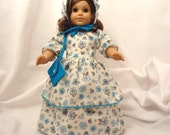 Turquoise, gold print on off white long dress for 18 inch dolls ith turquoise baby rick-rack trim.