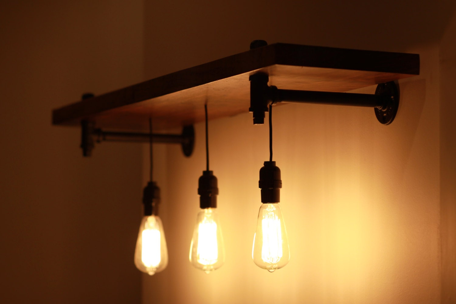 rustic wood and pipe shelf with pendant lighting