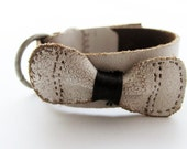 white leather cuff -- hold for Sarah