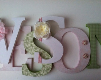 Wooden  letters for nursery in pink, green and white .