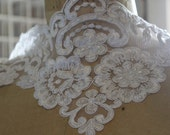 White Alencon Style Beaded Lace trim with Faux Pearls and sequins.6.5 inches wide.