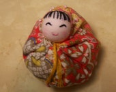 Japanese mini doll in pink, gold, yellow dress and pale pink beads