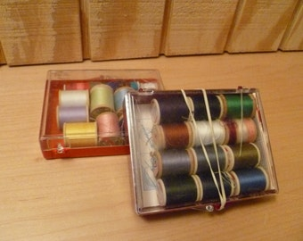 Two thread boxes, sewing kits