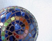 Cobalt blue mosaic ball, green spiral, broken china picassiette garden sculpture