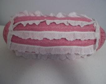 Decorative Pink Bolster w/ ruffles.