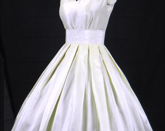A Gorgeous Ivory Shantung 50s style wedding dress, fully lined and shown wearing a petticoat