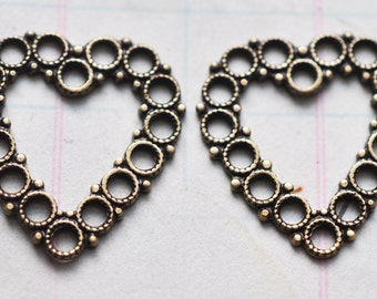 Four Filigree Heart Charms, Brass Oxidation