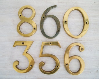 vintage brass number signs (only 0 and 6/9 left)