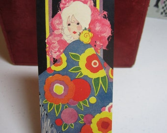 Gorgeous  1920s art deco unused bridge tally card platinum haired lady wearing elaborate fringed shawl and holding pink feather fan volland