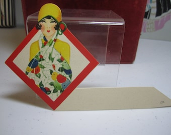 Gorgeous art deco 1920's-30's die cut place card pretty flapper girl wearing matching yellow cloche and clothing elaborate scarf flowing