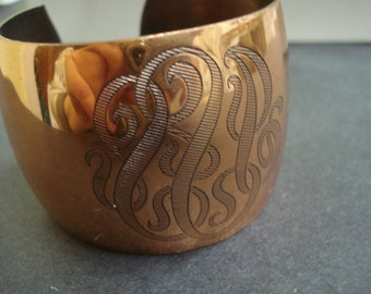 Mesmerazing Vintage Copper Color Cuff  Bracelet Decorated with Monograms Like Designs