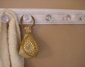 Gloss white Beautiful coat rack with 5 glass door knobs and decorative beveled moulding.  26""