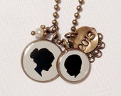 Mother & Child Silhouette Pendant Necklace with one large and one medium size pendant and stamped tag