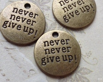 """20 mm Antiqued Bronze """"Never Give Up"""" Charm Pendants (.su)"""