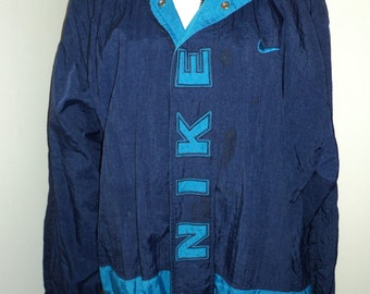 Vintage NIKE LABEL JACKET, 100% Nylon Jacket in Navy Blue with Aqua Blue Machine Embroidered  Letters sporting an Advertising  Iconic Label