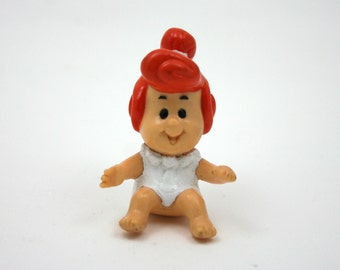 Vintage 1980s Wilma Flintstone, plastic cartoon figure, baby Flinstone, red top knot, modern stone age family, Hanna Barbera, happy meal