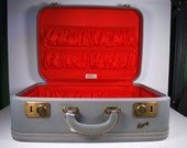 Vintage Skyway Light-Blue Medium Suitcase with Red Interior