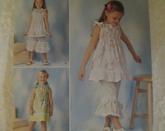 Simplicity 1628  Ruffles and Lace.  Girls Dress-top-Pants- Sizes 3-8