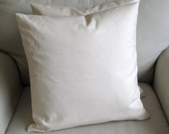 pair of ivory  organic cotton duck pillow covers with inserts