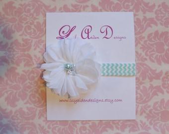 White jeweled flower on a aqua chevron headband/ Newborn headband/ baby headband